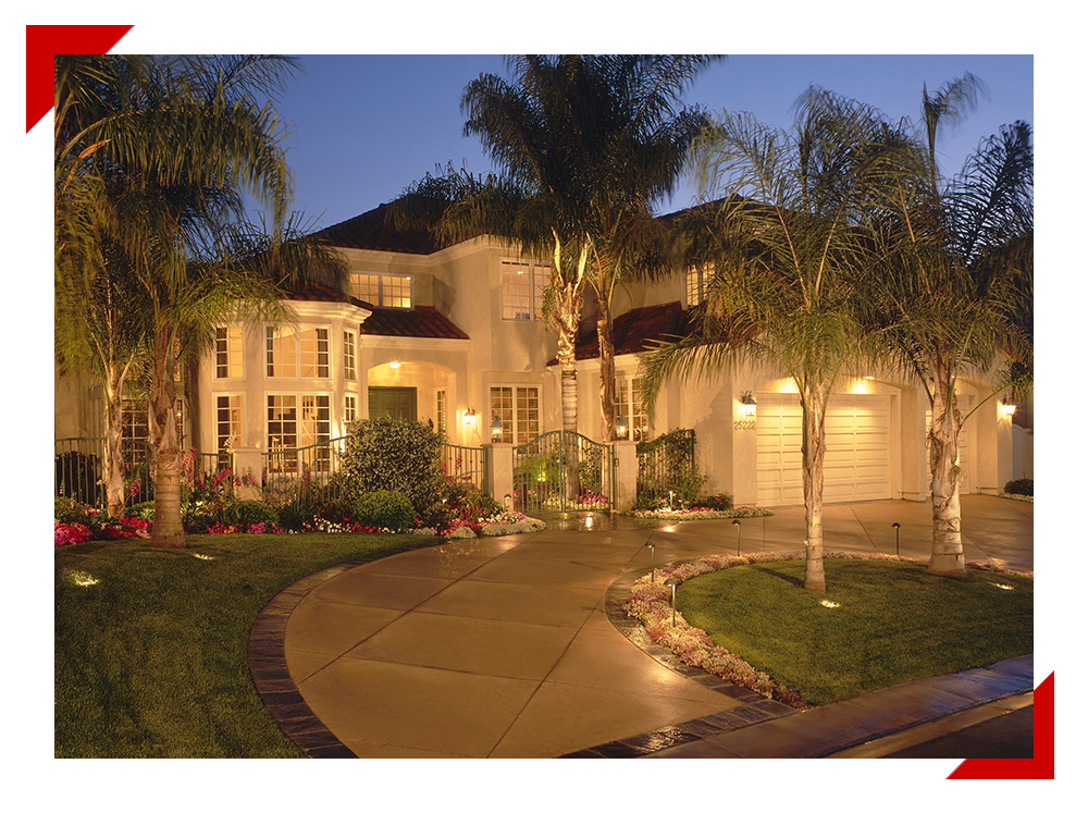 house with outdoor lighting system